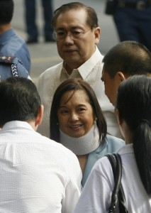 Former Philippine President Gloria Macapagal Arroyo arrives with husband, Jose Miguel, at the Sandiganbayan anti-graft court in Quezon City, Metro Manila, April 11, 2012. Arroyo entered a plead of not guilty to allegations of graft and corruption in the tainted telecommunications deal with China in 2007. REUTERS/Cheryl Ravelo (PHILIPPINES - Tags: POLITICS CRIME LAW)