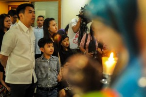 "Makati City Mayor Erwin ""Junjun"" Binay hears Mass along with his children before Senate representatives arrive to arrest him at Makati City Hall on Thursday. Mayor Binay was cited for contempt after failing to attend several hearings called by the Senate Blue Ribbon Sub-Committee regarding corruption issues in Makati. (MNS photo)"