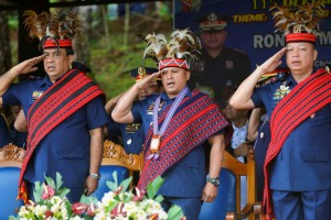"Philippine National Police Chief General Ronald ""Bato"" Dela Rosa (center) and other police officials salute as they wear local Igorot tribe headdress while singing the national anthem during a visit at the PNP Camp Dangwa in Benguet in this picture taken last Saturday. .(MNS photo)"