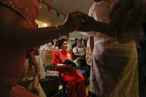 "Rep. Imelda Marcos sits with a book in her hands during the launch of their product, ""Imeldifique"" cooking wines, at a restaurant in Quezon City on Tuesday. The Marcoses are trying to solidify their return to power, with Sen. Bongbong Marcos running for vice president in the May 2016 elections.(MNS photo)"