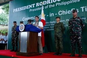 President Rodrigo Duterte delivers a message during his visit at the 10th Infantry Division in Compostela Valley on September 20. (MNS photo)