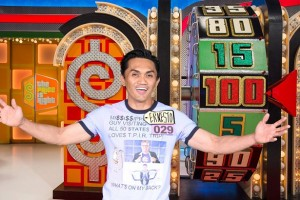 "Ernesto Paras Jr., a Filipino-American physical therapist, of Mississippi, rolls the giant wheel for the jackpot during his chance at ""The Price is Right."""