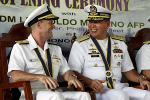 Philippine Navy Rear Admiral Leopoldo Alano (right) shares a light moment with U.S. Navy Rear Admiral William Merz during the opening ceremony on Monday of the joint exercise between the two countries' navies in Puerto Princesa, Palawan, the nearest province in the disputed Spratly Islands.  (MNS photo)