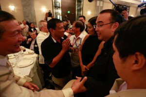 -- Presidential candidate Davao Mayor Rodrigo Duterte and running mate Sen. Alan Peter Cayetano arrive at the Makati Business Club forum on Wednesday. Duterte talked about his plans on how to fight crime and corruption, and said he is not the man he is portrayed to be by some.(MNS photo)