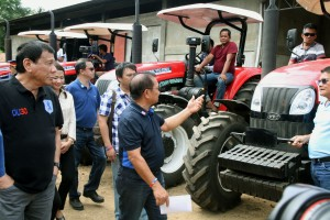 President Duterte, Agriculture Secretary Manny Pinol distribute 7 units farm tractor in Basilan: President Rodrigo Roa Duterte, together with Agriculture Secretary Manny Pinol, view the 7 units of farm 4WD Farm Tractor for farmers at Limo-ok Lamitan City, Basilan Province on Monday (October 10, 2016). (PNA photo by Oliver Marquez)