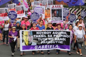 Members of ProGay and women's rights group in a rally to denounce the alleged government inaction on violence against women. After days of a thorough investigation, the suspect in her death, as US Marine, has been charged with murder. (MNS photo)