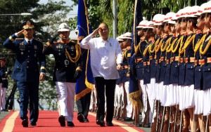 President Benigno S. Aquino III troops the line upon his arrival at Camp Crame for the commemoration of  the Mamasapano Massacre Monday (January 25). The President will present the PNP Medalya ng Kabayanihan to relatives of the  44 SAF troopers who were slain in the massacre. (MNS photo)